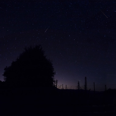 Panorama of night sky during meteor shower