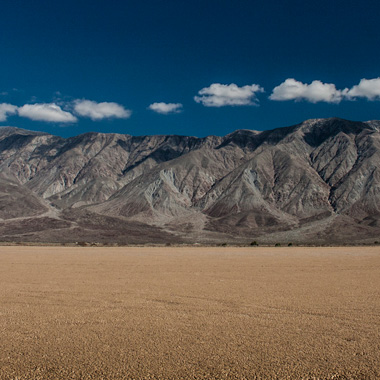 Beautiful mountains and a deep blue sky over a dry lake bed